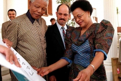 At Mandela's Pretoria residence in 1998, he and Graca Machel examine a birthday card for him from his former prison guard. Mandela and Machel were married later that day in Johannesburg.